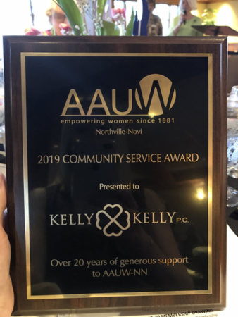 Plaque award with the title 2019 community service award presented to Kelly Kelly P.C.