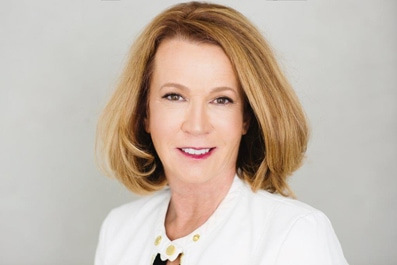 Headshot photo of a woman attorney wearing a white blouse. This is Michele Kelly a criminal defense and family law attorney at Kelly & Kelly.