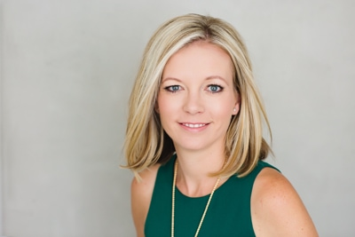 Headshot of attorney Ryan Kelly a young blonde female family law attorney wearing a green blouse.