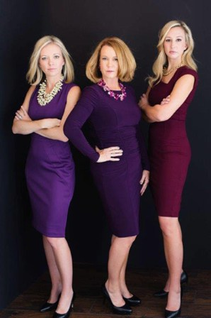 Professional group picture of the high conflict divorce legal team at Kelly & Kelly. There are three women attorneys in professional business attire in the photo.