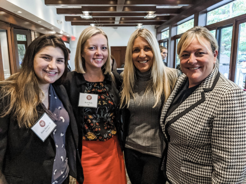 Family law attorney Ryan Kelly attending Mercy High School's Women in Law event taking a photo with three other women