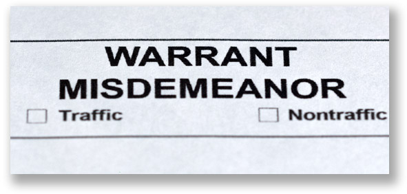 Top of a Michigan court form that's titled warrant misdemeanor and has two checkmark boxes for traffic and nontraffic